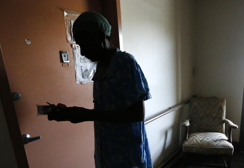 Janet Arnett looks for her keys as she prepares to lock her apartment door in Epiphany House, a low-income senior home in Baltimore, Tuesday, July 3, 2012, as she awaits return of electricity for the first time since last weekend's severe storms. Utility crews struggled Tuesday to restore power to more than 1 million people in the eastern U.S. as frustration grew four days after storms that have led to 24 deaths so far. Officials worried the toll could rise because of stifling conditions and generator fumes. (AP Photo/Patrick Semansky)