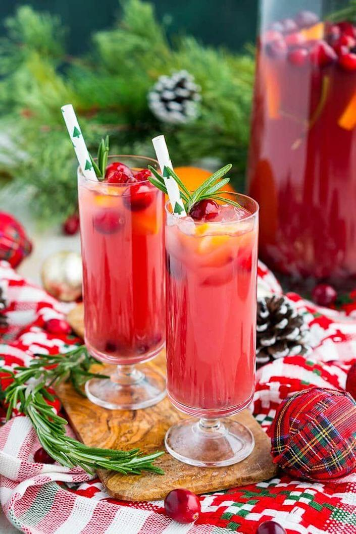 """<p>Pour this punch into champagne flutes to immediately elevate the vibe of any holiday gathering. You can also choose to keep it non-alcoholic—or add rum or vodka for extra fun.</p><p><strong>Get the recipe at <a href=""""https://www.sugarandsoul.co/christmas-punch-recipe/"""" rel=""""nofollow noopener"""" target=""""_blank"""" data-ylk=""""slk:Sugar and Soul."""" class=""""link rapid-noclick-resp"""">Sugar and Soul.</a></strong> </p>"""