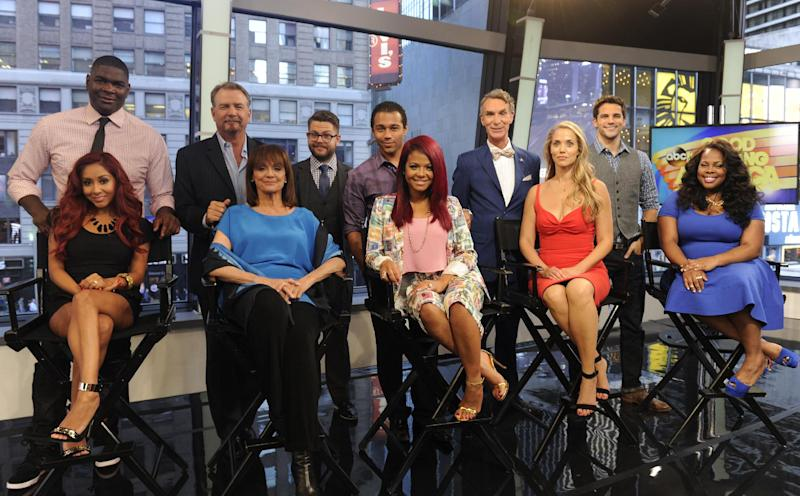 """This image released by ABC shows, standing from left, NFL wide receiver Keyshawn Johnson, comic Bill Engvall, TV personality Jack Osbourne, actor Corbin Bleu, Bill Nye, the """"Science Guy,"""" actor Brant Daugherty, and seated from left, TV personality Nicole """"Snooki"""" Polizzi, actress Valerie Harper, singer-actress Christina Milian, actress Elizabeth Berkley and actress Amber Riley on """"Good Morning America,"""" Wednesday, Sept. 4, 2013 in New York. These 11 celebrities, along with actress Leah Remini, will be the next celebrity contestants on the dance competition series """"Dancing with the Stars,"""" premiering Sept. 16. (AP Photo/ABC, Ida Mae Astute)"""
