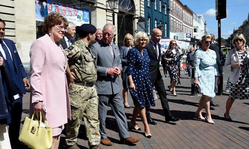 The Prince of Wales and Duchess of Cornwall walk through Salisbury