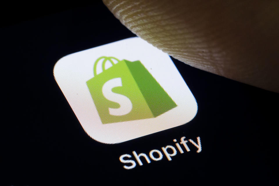 BERLIN, GERMANY - SEPTEMBER 18: In this photo illustration the logo of Canadian e-commerce company Shopify Inc. is displayed on a smartphone on September 18, 2019 in Berlin, Germany. (Photo Illustration by Thomas Trutschel/Photothek via Getty Images)