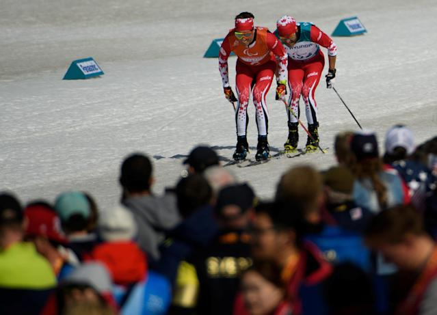 Brian McKeever CAN with his guide Russell Kennedy race to the finish line in the Cross-Country Skiing Visually Impaired Men's 1.5km Sprint Classic Final at the Alpensia Biathlon Centre. The Paralympic Winter Games, PyeongChang, South Korea, Wednesday 14th March 2018. OIS/IOC/Thomas Lovelock/Handout via REUTERS