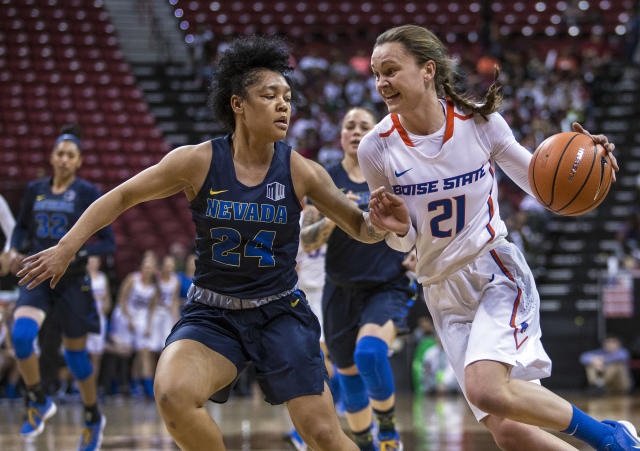 Nevada guard Camariah King (24) defends as Boise State guard Riley Lupfer (21) drives the lane during second quarter of an NCAA college basketball game for the Mountain West women's tournament championship Friday, March 9, 2018, in Las Vegas. (AP Photo/L.E. Baskow)