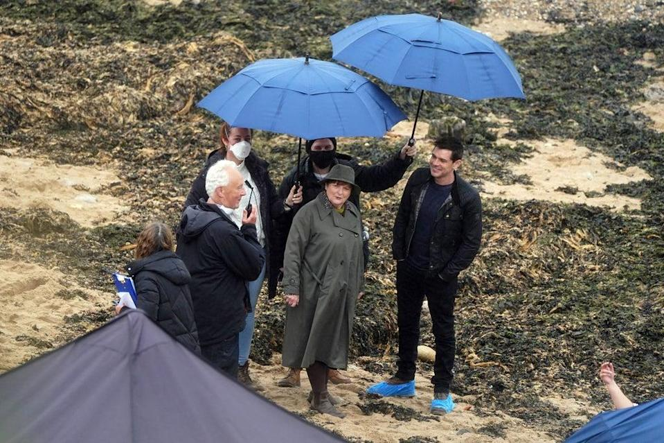 Brenda Blethyn, who plays DCI Vera Stanhope, and Kenny Doughty, who plays DS Aiden Healy, on set during filming of ITV crime drama Vera in Tynemouth, North Tyneside (Owen Humpheys/PA) (PA Wire)