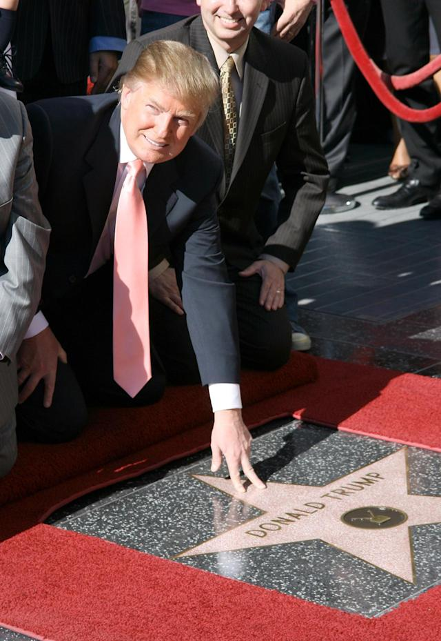 <p>Trump is honored with a star on the Hollywood Walk of Fame on Jan. 16, 2007. <i>(Photo: M. Tran/FilmMagic)</i> </p>