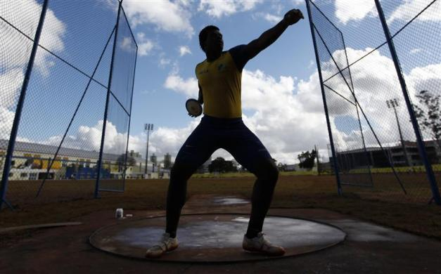 Brazilian Ronald Juliao prepares to throw a discus during a training session at the Athletics Center in Sao Caetano do Sul, near Sao Paulo May 17, 2012. Juliao will be taking part in the 2012 London Olympics.