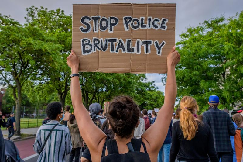 Hundreds of protesters flooded the streets of Crown Heights in Brooklyn to demand the defunding of the police force and to demonstrate against police brutality in the wake of George Floyd's death. (Photo: Erik McGregor/LightRocket via Getty Images)