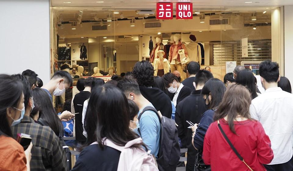 Uniqlo is the first company hit under the new rules for workplace infections. Photo: Martin Chan