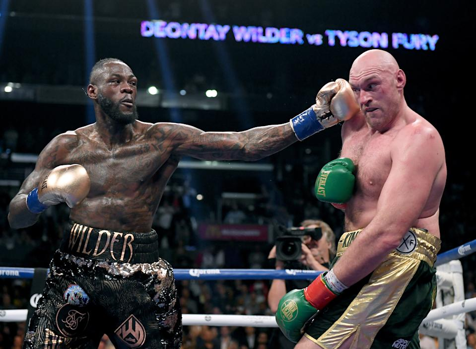 LOS ANGELES, CA - DECEMBER 01:  Deontay Wilder punches Tyson Fury in the ninth round fighting to a draw during the WBC Heavyweight Championship at Staples Center on December 1, 2018 in Los Angeles, California.  (Photo by Harry How/Getty Images)