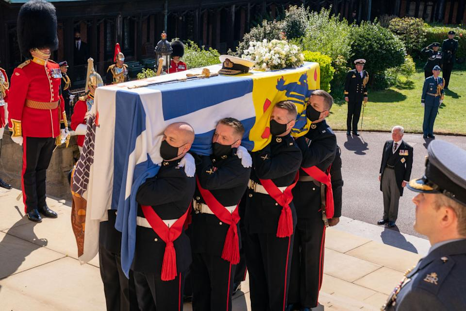 The coffin of Prince Philip is carried up the steps of St George's Chapel in Windsor by eight Pall Bearers