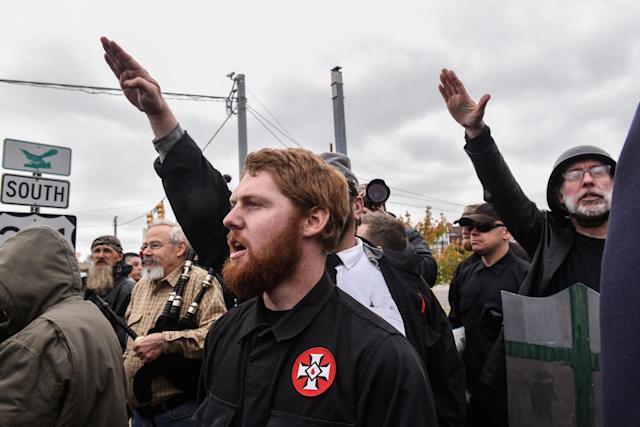 """<p>People gesture while participating in a """"White Lives Matter"""" rally in Shelbyville, Tenn., Oct. 28, 2017. (Photo: Stephanie Keith/Reuters) </p>"""