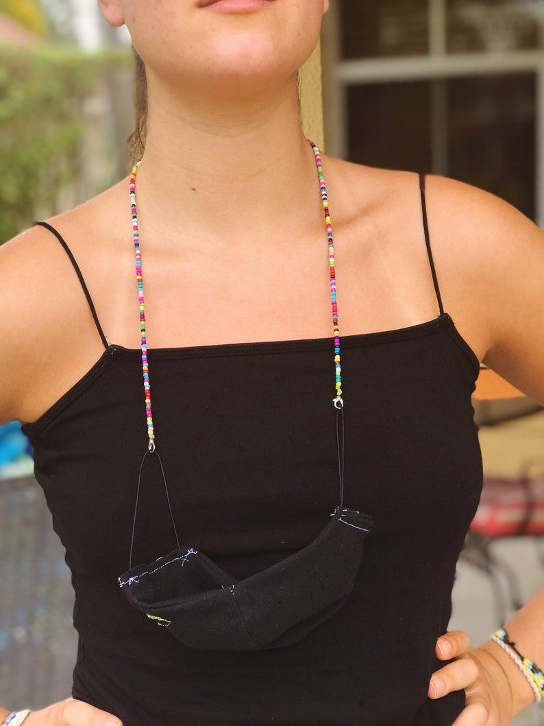 """<br><br><strong>FireflyFeelingBright</strong> Face Mask Chain, $, available at <a href=""""https://go.skimresources.com/?id=30283X879131&url=https%3A%2F%2Fwww.etsy.com%2Flisting%2F811129873%2Fface-mask-chain%3Fga_order%3Dmost_relevant%26ga_search_type%3Dall%26ga_view_type%3Dgallery%26ga_search_query%3Dmask%2Baccessory%26ref%3Dsr_gallery-1-30%26frs%3D1%26bes%3D1"""" rel=""""nofollow noopener"""" target=""""_blank"""" data-ylk=""""slk:Etsy"""" class=""""link rapid-noclick-resp"""">Etsy</a>"""
