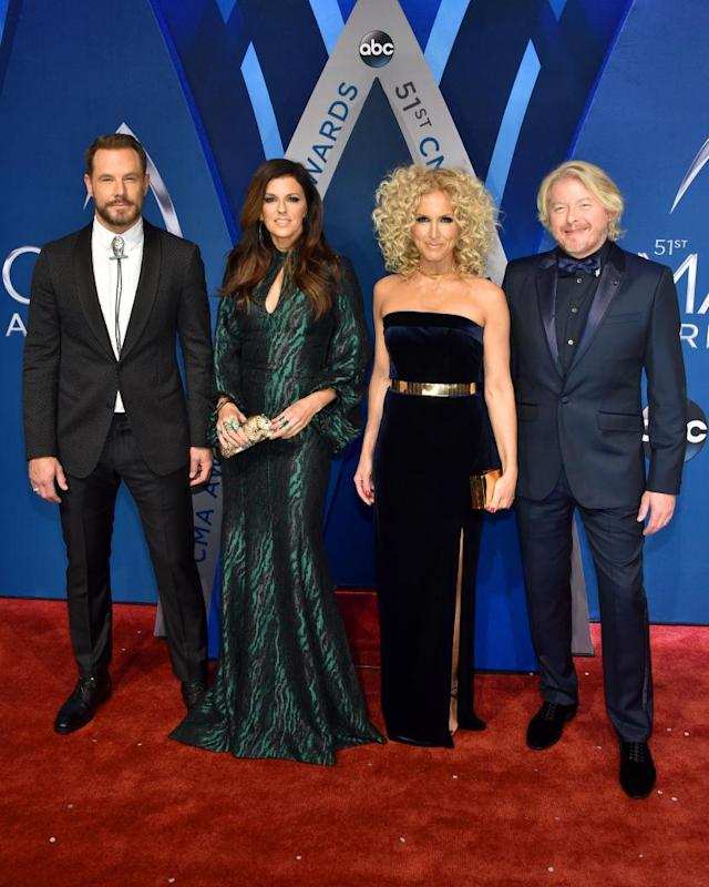 <p>They're the squad that everybody wants to be a part of. The members of Little Big Town all look suited and booted for the big night. (Photo: Getty Images) </p>