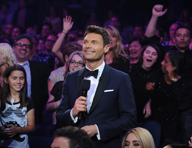 """FILE - In this May 16, 2013 file image released by Fox, host Ryan Seacrest appears during the season 12 finale of """"American Idol,"""" in Los Angeles. NBC says Ryan Seacrest will host """"The Million Second Quiz,"""" a new live game show the network hopes will become event programming for two weeks in September. (AP Photo/Fox, Ray Mickshaw, File)"""