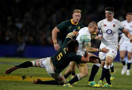 South Africa's Franco Mostert tackles England's Mike Brown. REUTERS/Siphiwe Sibeko