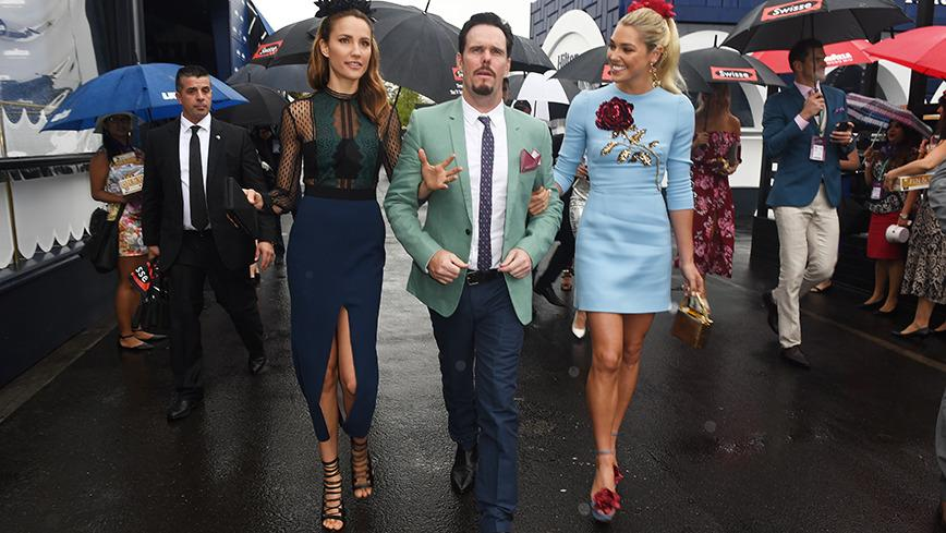 <p>Now that's how you make an entrance! 'Entourage' star Kevin Dillion strutted into Oaks Day on the arms of two models. Nice work, if you can get it.</p>