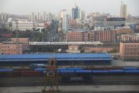 Freight cars are seen at a train station in Dandong