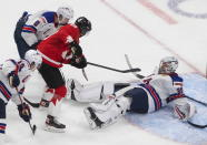 Canada's Peyton Krebs (18) is stopped by United States goalie Spencer Knight (30) during the third period of the championship game in the IIHF World Junior Hockey Championship, Tuesday, Jan. 5, 2021, in Edmonton, Alberta. (Jason Franson/The Canadian Press via AP)
