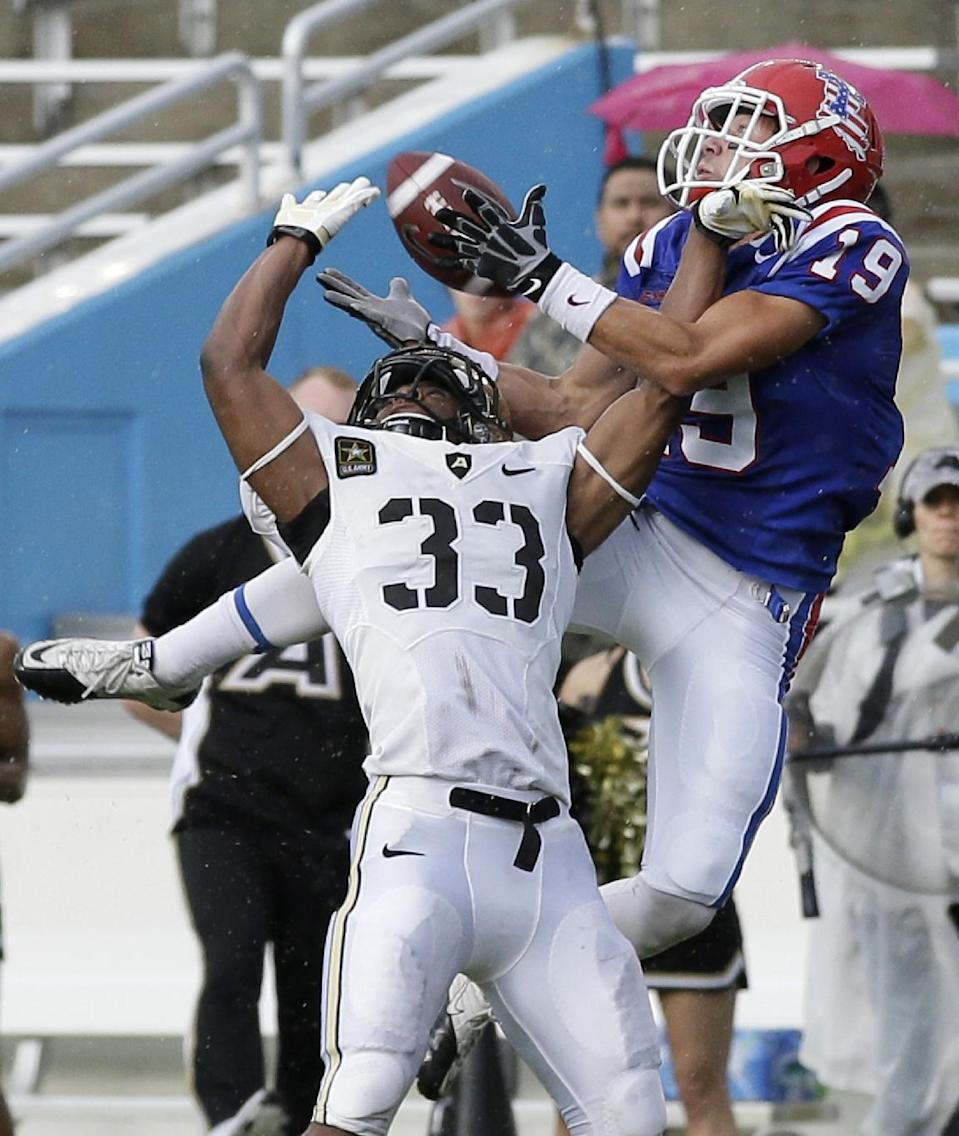 Army defensive back Shaquille Tolbert (33) defends as Louisiana Tech wide receiver Andrew Guillot (19) comes down with a reception in the end zone for a touchdown in the first half of a NCAA college football game, Saturday, Sept. 28, 2013, in Dallas. (AP Photo/Tony Gutierrez)