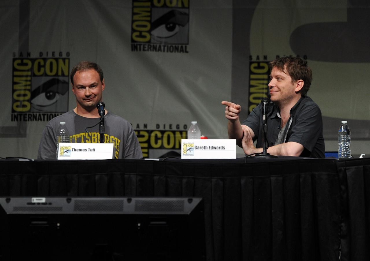 "SAN DIEGO, CA - JULY 14:  Producer Thomas Tull (L) and Gareth Edwards speak at Warner Bros. Pictures and Legendary Pictures Preview of ""Pacific Rim"" during Comic-Con International 2012 at San Diego Convention Center on July 14, 2012 in San Diego, California.  (Photo by Kevin Winter/Getty Images)"