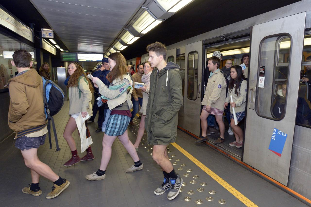 "People take part in the annual ""No Pants Subway Ride"" in the subway in Brussels, January 12, 2014. The event involves participants who strip down to their underwear as they go about their normal routine, and occurs in different cities around the world in January, according to its organisers. REUTERS/Eric Vidal (BELGIUM - Tags: TRANSPORT SOCIETY ANNIVERSARY)"