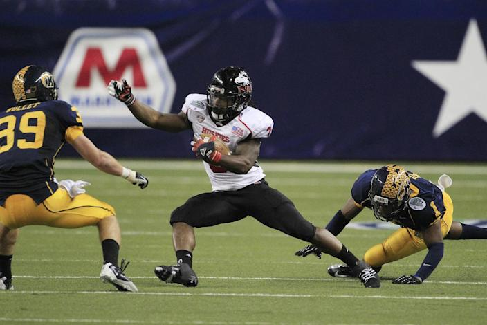 Northern Illinois running back Akeem Daniels (3) is chased by Kent State cornerback Darius Polk (1) and safety Luke Wollet (39) during the second quarter of the Mid-American Conference championship NCAA college football game on Friday, Nov. 30, 2012. (AP Photo/Carlos Osorio)