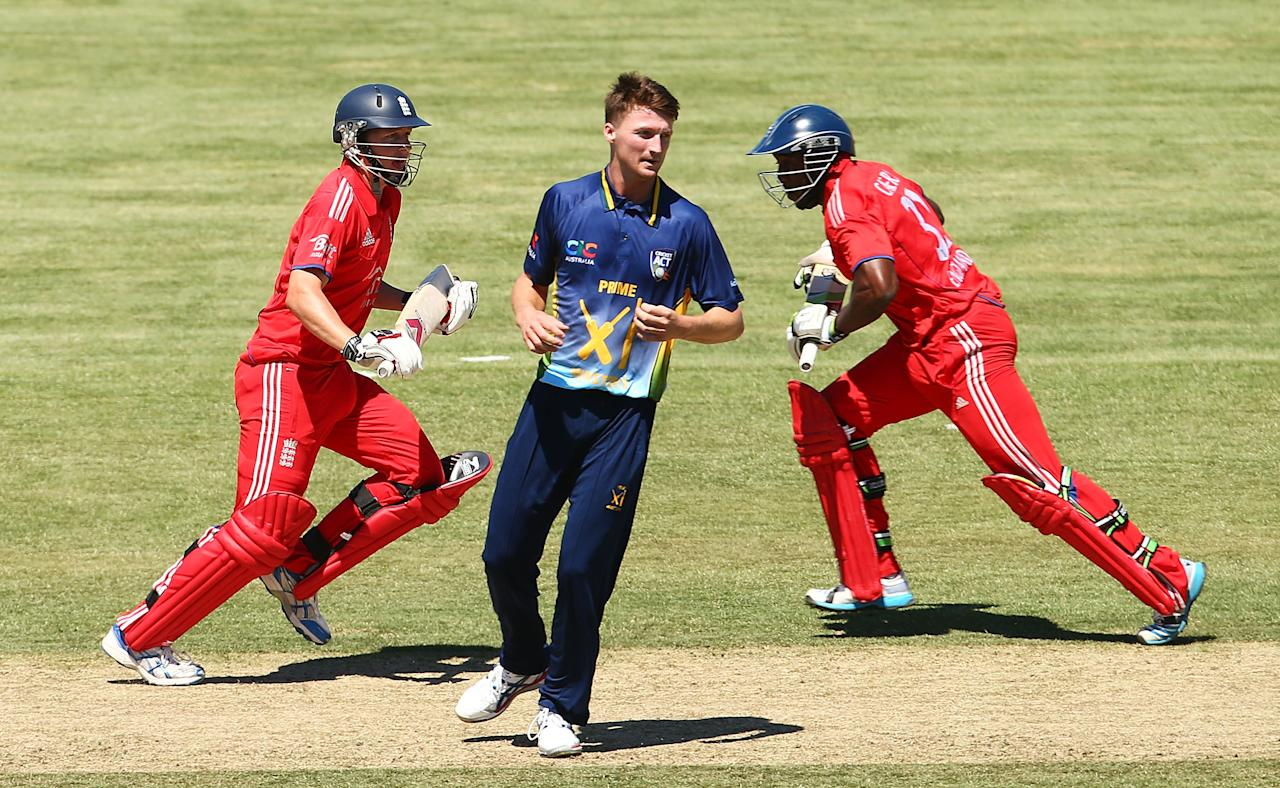 CANBERRA, AUSTRALIA - JANUARY 14:  Gary Balance and Michael Carberry of England run between wickets as Jackson Bird of the PM's XI watches on during the International tour match between the Prime Minister's XI and England at Manuka Oval on January 14, 2014 in Canberra, Australia.  (Photo by Mark Nolan/Getty Images)