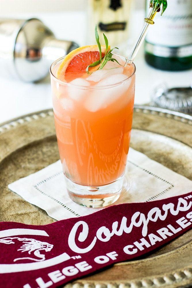 """<p>This refreshing cocktail hits all the right notes. It gets a bit of tang from grapefruit, a hint of sweetness from elderflower liqueur, and just a touch of earthiness from tarragon sprigs. </p><p>Get the recipe at <a href=""""https://thebeachhousekitchen.com/the-charleston-fizz/"""" rel=""""nofollow noopener"""" target=""""_blank"""" data-ylk=""""slk:The Beach House Kitchen"""" class=""""link rapid-noclick-resp"""">The Beach House Kitchen</a>. </p>"""