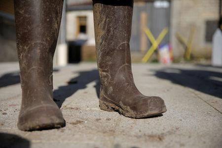 """The boots of an opponent to the project of an underground nuclear waste disposal of the French National Radioactive Waste Management Agency ANDRA called CIGEO, who wanted to stay anonymous, are seen during an inverview with Reuters journalists in front of the """"house of resistance"""" in Bure, Eastern France, April 6, 2018. Picture taken April 6, 2018. REUTERS/Vincent Kessler"""