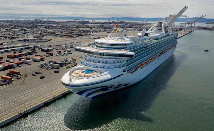 The Grand Princess docks at the Port of Oakland in Oakland, Calif., on March 9, 2020. The cruise ship, which had maintained a holding pattern off the coast for days, is carrying multiple people who tested positive for COVID-19, a disease caused by the new coronavirus.
