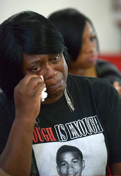 Nichole Mitchell wipes away tears during the sermon at a youth service at the St. Paul Missionary Baptist Church in Sanford, Fla., Sunday, July 14, 2013. Many in the congregation wore shirts in support of Trayvon Martin following the acquittal oif George Zimmerman, who had been charged in the 2012 shooting death of Martin.(AP Photo/Phelan M. Ebenhack)