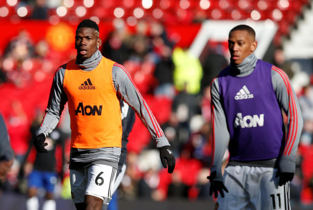 "Soccer Football - Premier League - Manchester United vs Chelsea - Old Trafford, Manchester, Britain - February 25, 2018 Manchester United's Paul Pogba and Anthony Martial warm up before the match REUTERS/Andrew Yates EDITORIAL USE ONLY. No use with unauthorized audio, video, data, fixture lists, club/league logos or ""live"" services. Online in-match use limited to 75 images, no video emulation. No use in betting, games or single club/league/player publications. Please contact your account representative for further details."