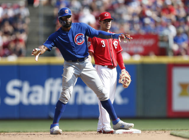 Chicago Cubs right fielder Jason Heyward, left, reaches second on an infield single by Addison Russell as Cincinnati Reds second baseman Scooter Gennett (3) defends during the fifth inning of a baseball game, Saturday, June 29, 2019, in Cincinnati. (AP Photo/Gary Landers)