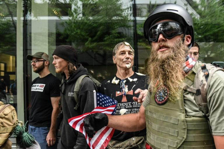 A far-right demonstrator is covered in mayonnaise after being chased by a group of counter-protesters during a rally on August 17 in Portland, Oregon (AFP Photo/STEPHANIE KEITH)