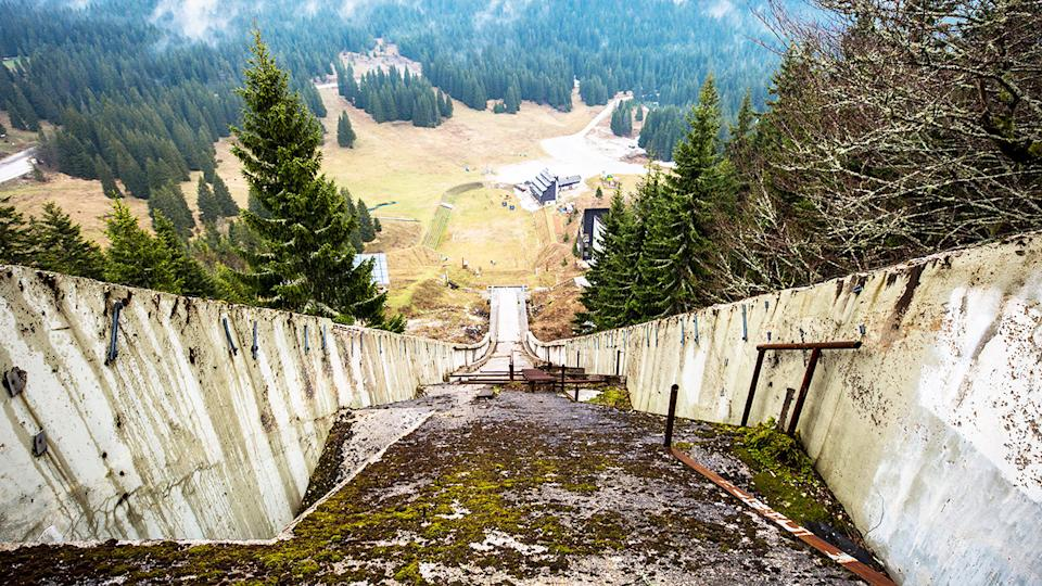 The giant ski jump, pictured here lying in wrack and ruin.