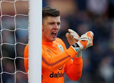 Soccer Football - Premier League - Burnley vs Southampton - Turf Moor, Burnley, Britain - February 24, 2018 Burnley's Nick Pope gestures REUTERS/Andrew Yates