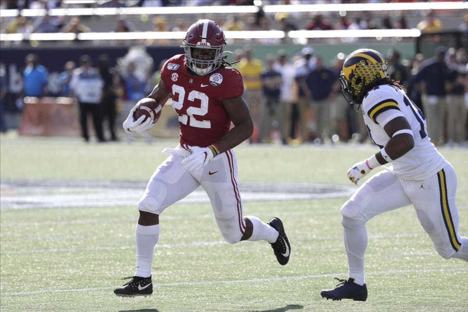 Alabama running back Najee Harris (22) runs against Michigan during the first half of the Citrus Bowl NCAA college football game, Wednesday, Jan. 1, 2020, in Orlando, Fla. (AP Photo/John Raoux)