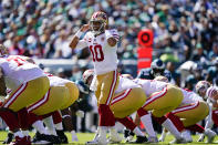 San Francisco 49ers quarterback Jimmy Garoppolo (10) calls out to his team during the first half of an NFL football game against the Philadelphia Eagles on Sunday, Sept. 19, 2021, in Philadelphia. (AP Photo/Matt Rourke)