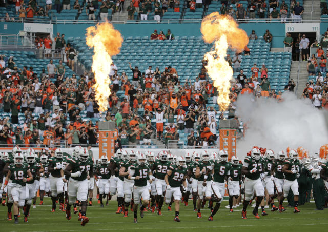 Miami runs onto the field before an NCAA college football game Against Virginia, Saturday, Nov. 18, 2017, in Miami Gardens, Fla. (AP Photo/Lynne Sladky)
