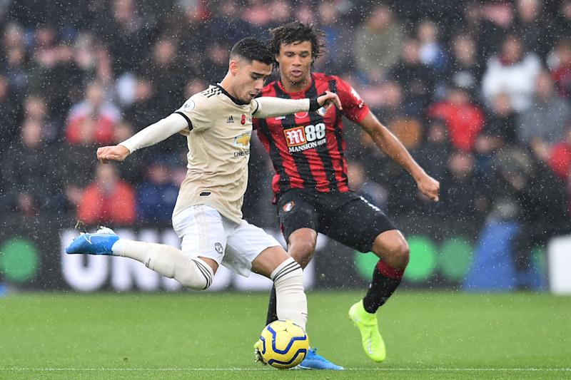 Manchester United's Belgian-born Brazilian midfielder Andreas Pereira (L) plays the ball under pressure from Bournemouth's Dutch defender Nathan Ake (R) during the English Premier League football match between Bournemouth and Manchester United at the Vitality Stadium in Bournemouth, southern England on November 2, 2019. (Photo by Glyn KIRK / AFP) / RESTRICTED TO EDITORIAL USE. No use with unauthorized audio, video, data, fixture lists, club/league logos or 'live' services. Online in-match use limited to 120 images. An additional 40 images may be used in extra time. No video emulation. Social media in-match use limited to 120 images. An additional 40 images may be used in extra time. No use in betting publications, games or single club/league/player publications. / (Photo by GLYN KIRK/AFP via Getty Images)
