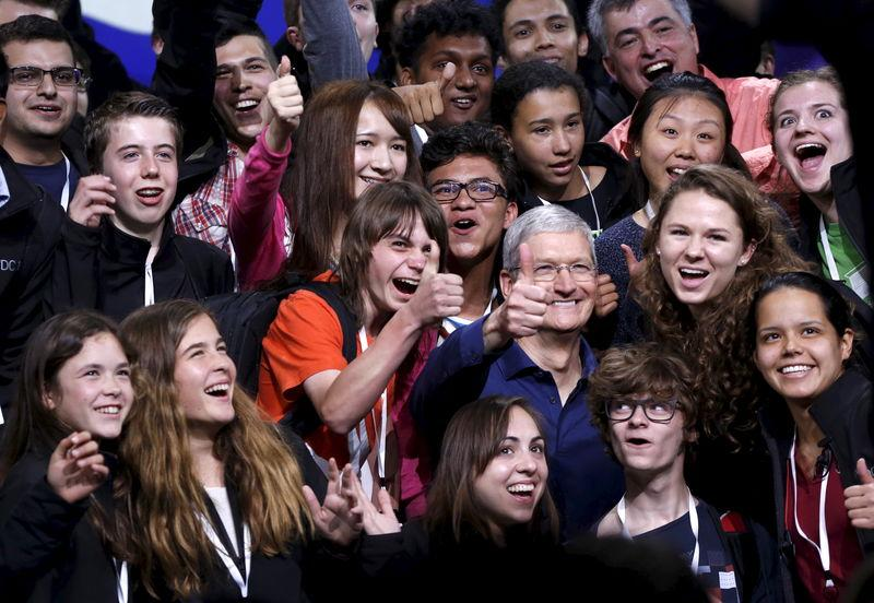 Apple CEO Tim Cook poses with scholarship winners following his keynote address at the Worldwide Developers Conference in San Francisco