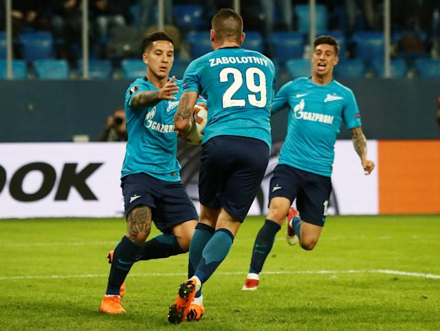 Soccer Football - Europa League Round of 16 Second Leg - Zenit Saint Petersburg vs RB Leipzig - Stadium St. Petersburg, Saint Petersburg, Russia - March 15, 2018 Zenit St. Petersburg's Sebastian Driussi celebrates with Anton Zabolotny after scoring their first goal REUTERS/Maxim Shemetov