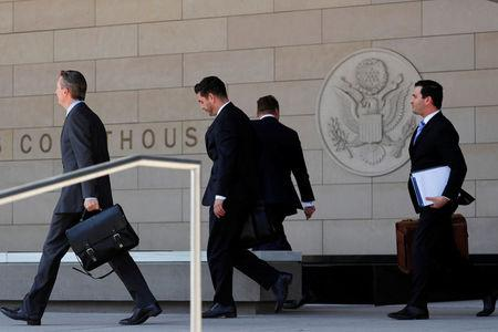 Lawyers representing Michael Cohen and U.S. President Donald Trump arrive at U.S. District Court to deal with a case involving Stephanie Clifford, also known as Stormy Daniels, in Los Angeles, California, U.S., April 20, 2018. REUTERS/Mike Blake