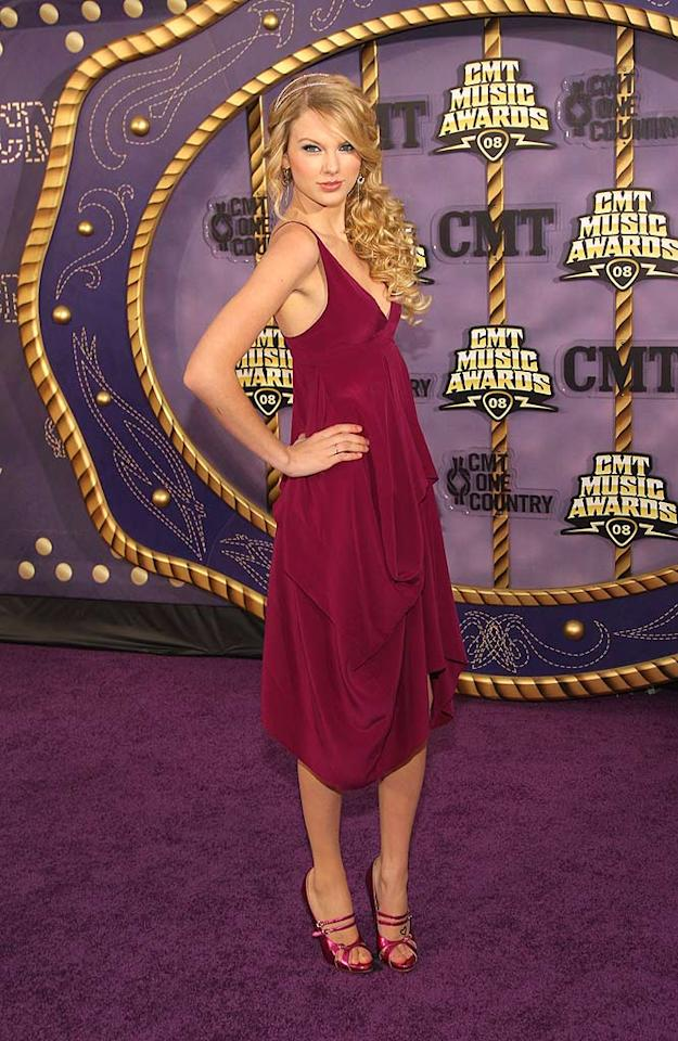 "Taylor Swift's raspberry gown accentuated her long and lean figure. The 18-year-old won the Video of the Year Award for ""Our Song."" Stephen Lovekin/<a href=""http://www.gettyimages.com/"" target=""new"">GettyImages.com</a> - April 14, 2008"