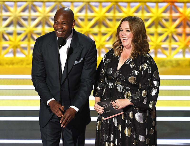 Comedian Dave Chappelle and actor Melissa McCarthy speak onstage during the 69th Annual Primetime Emmy Awards at Microsoft Theater on Sept. 17, 2017 in Los Angeles, California.