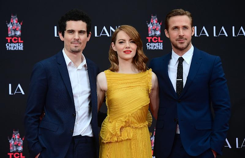 "Directed by Damien Chazelle (L) and starring Emma Stone and Ryan Gosling, ""La La Land"" has charmed critics and returned more than 10 times its $30 million budget (AFP Photo/Frederic J. BROWN)"