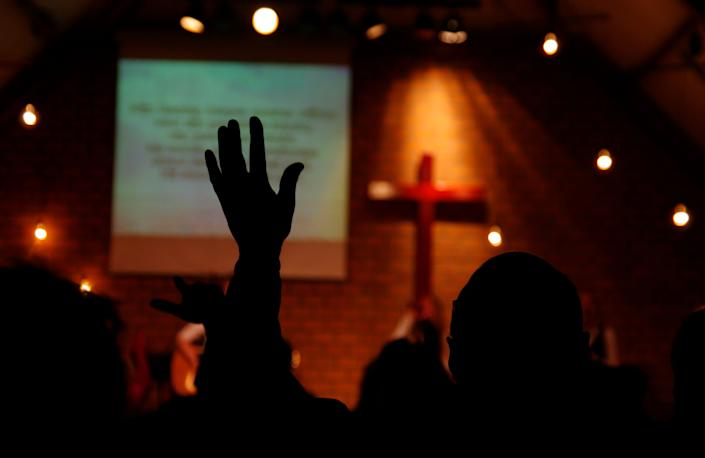 White evangelicals who attend church frequently are more likely than less frequent attenders to hold racist views, Robert Jones argues in a new book. (Photo: middelveld via Getty Images)