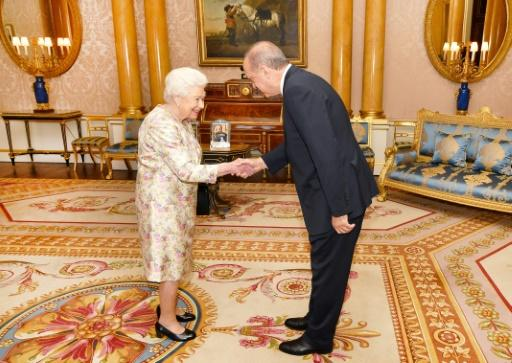Britain's Queen Elizabeth II greets Turkey's President Recep Tayyip Erdogan during a private audience at Buckingham Palace in London