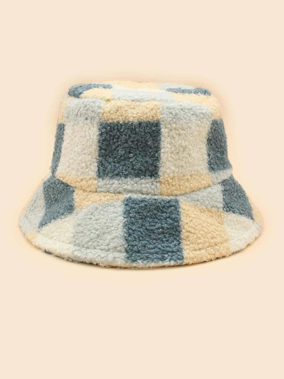 <p>Go for a bold look with this bright <span>Colorblock Plush Bucket Hat</span> ($7).</p>