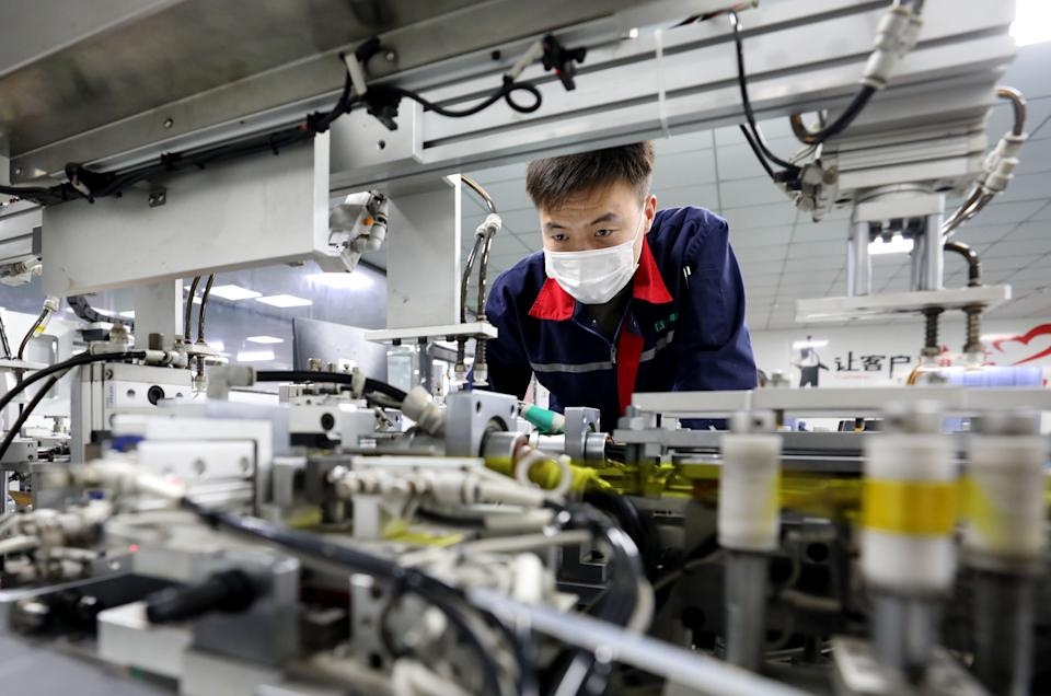 HUAIBEI, CHINA - FEBRUARY 27: An employee works at a lithium-ion battery manufacturing plant on February 27, 2021 in Huaibei, Anhui Province of China. (Photo by Li Xin/VCG via Getty Images)